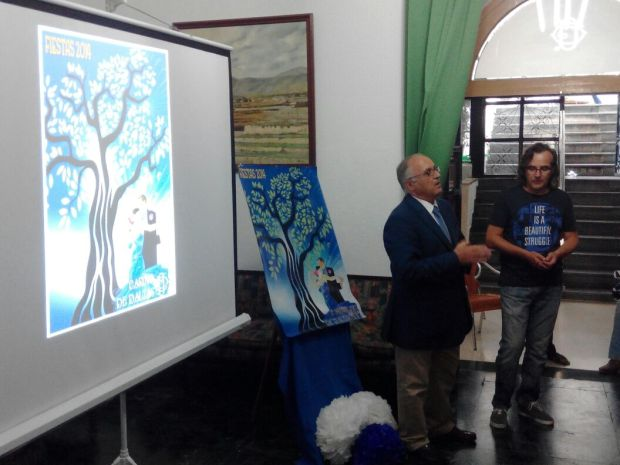 Jose Gabriel García Lirola, presidente de la entidad, y José María Muñoz Vilchez, autor del cartel